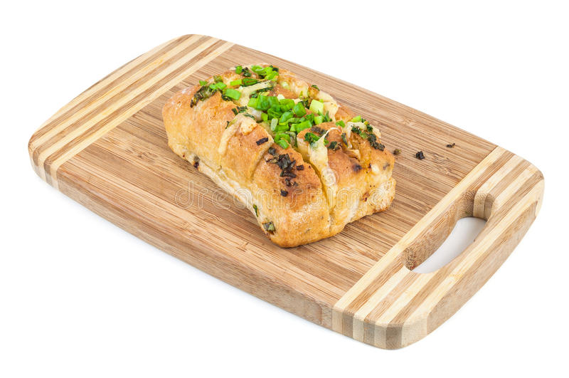 Gebackenes ciabatta (italienisches Brot) auf hackendem Brett lizenzfreies stockbild