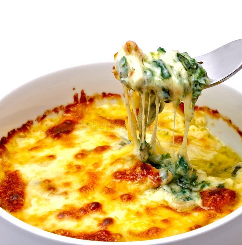 Gebakken spinazie met kaas stock afbeelding