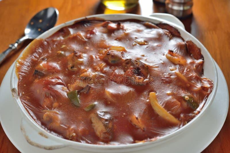 Gebakken tomatenvarkensvlees stock afbeelding