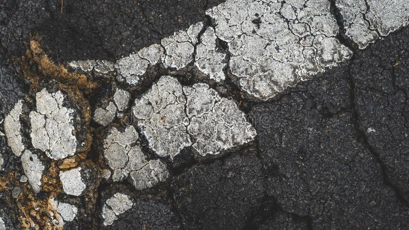 Gebarsten Asphalt Road Texture Background Photo royalty-vrije stock foto
