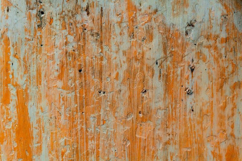 Gebarsten concrete uitstekende muurachtergrond, oude muur stock foto