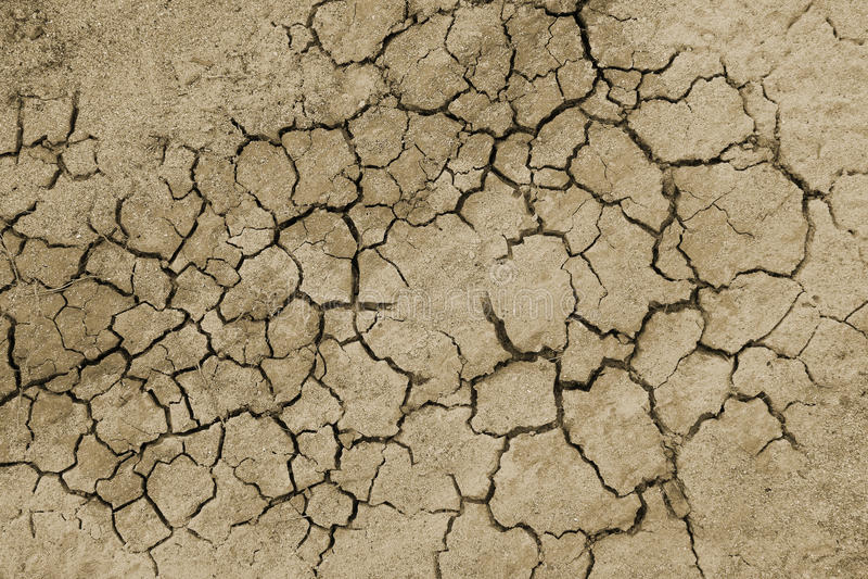 Gebarsten droge grondachtergrond stock foto