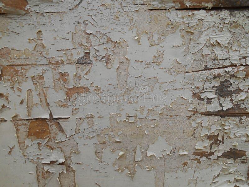 Gebarsten en beschadigd verfpatroon op houten oppervlakte, achtergrond stock afbeeldingen