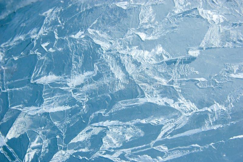 Gebarsten ijsoppervlakte (achtergrond, textuur) royalty-vrije stock afbeeldingen