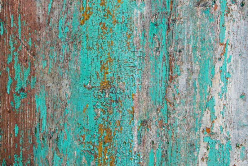 Gebarsten oude houten muur met geweven verf, heldere achtergrond c stock foto