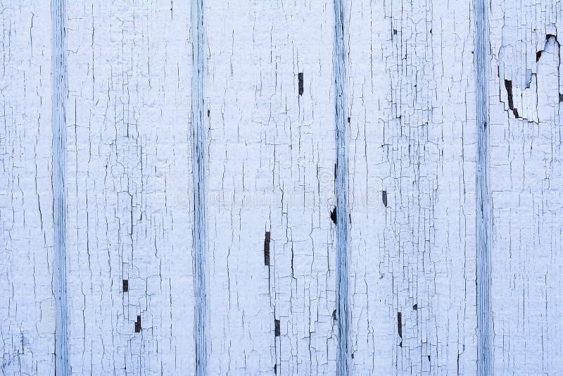 Gebarsten verf op houten muur stock foto