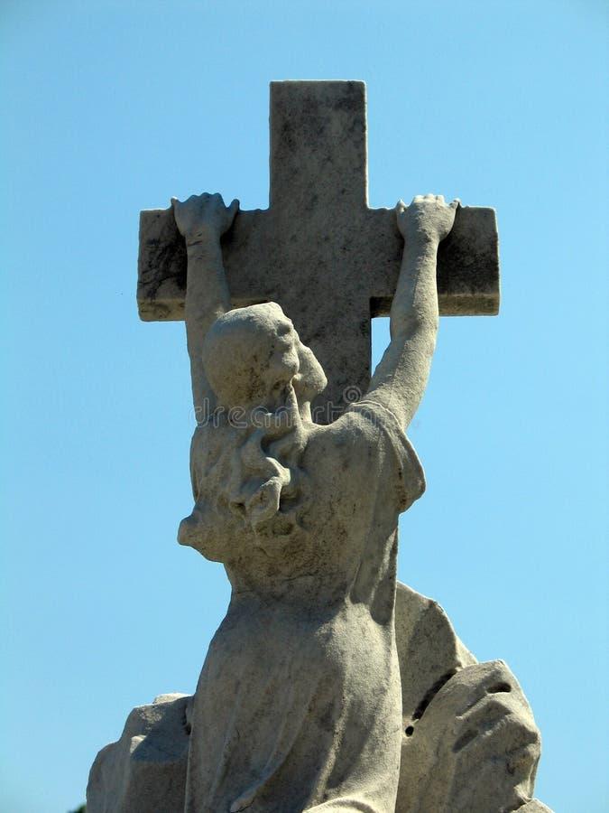 Gebed op een kruis royalty-vrije stock afbeelding