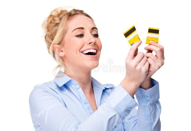 Geben Sie von der Schuld-Frauen-Ausschnitt-Gutschrift-Kreditkarte frei stockbilder