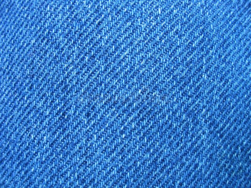 Gebissen vom blauen Baumwollstoff stockfotos