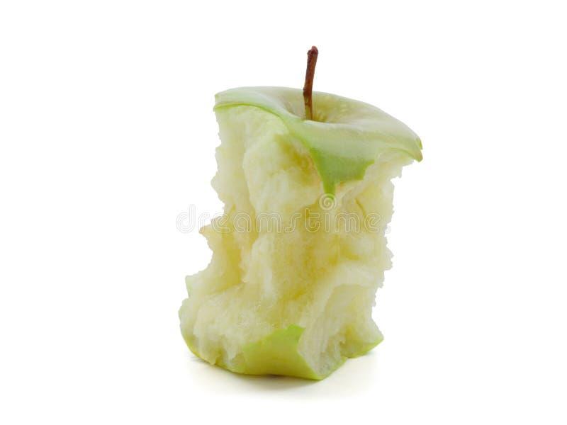 Gebissener grüner Apfel auf einem weißen Hintergrund stockfotos