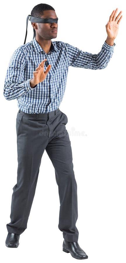 Geblinddochte zakenman met uit wapens stock fotografie