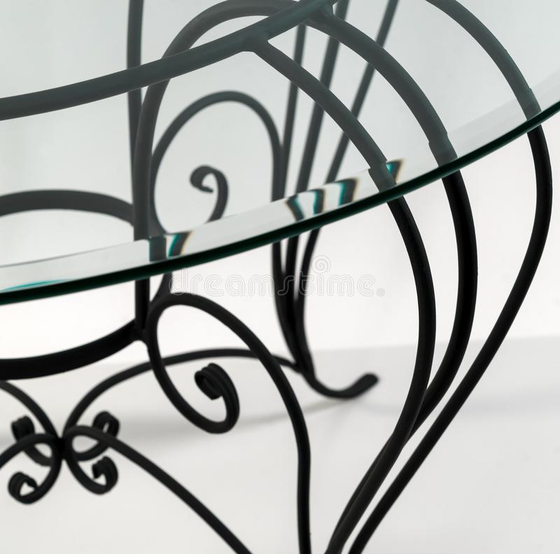 Gebogen ornamenten van smeedijzer Detail van lijst stock fotografie