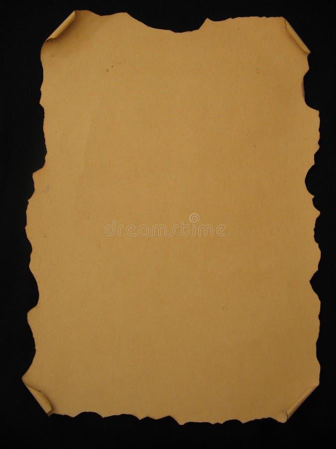 Gebogenes gebranntes braunes Pergament lizenzfreie stockfotografie