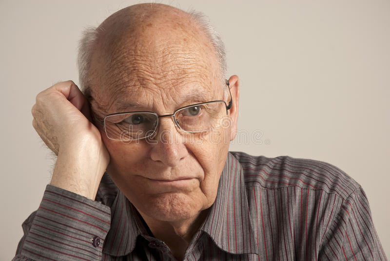 Gebohrter älterer Mann stockfotografie