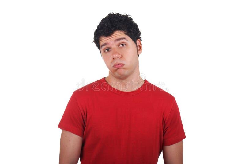 Gebohrter junger Mann, der lustiges Gesicht macht stockbilder