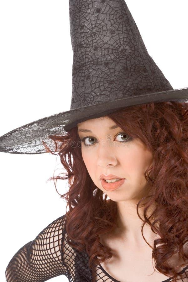 Gebohrtes jugendlich Mädchen des gelesenen Kopfes im Halloween-Hut stockbilder