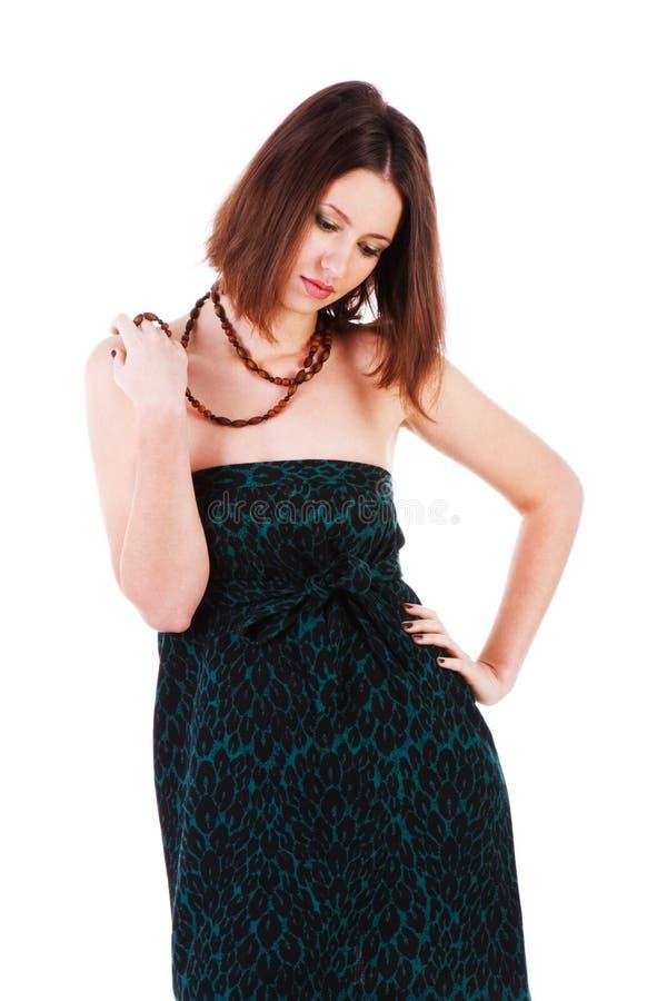 Gebohrtes Mädchen im grünen Kleid stockfotografie