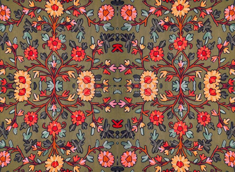 Geborduurd bloemenpatroon op de stof royalty-vrije stock afbeeldingen