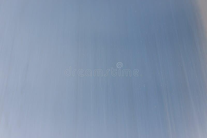 Geborstelde aluminiumoppervlakte met stroken stock afbeelding