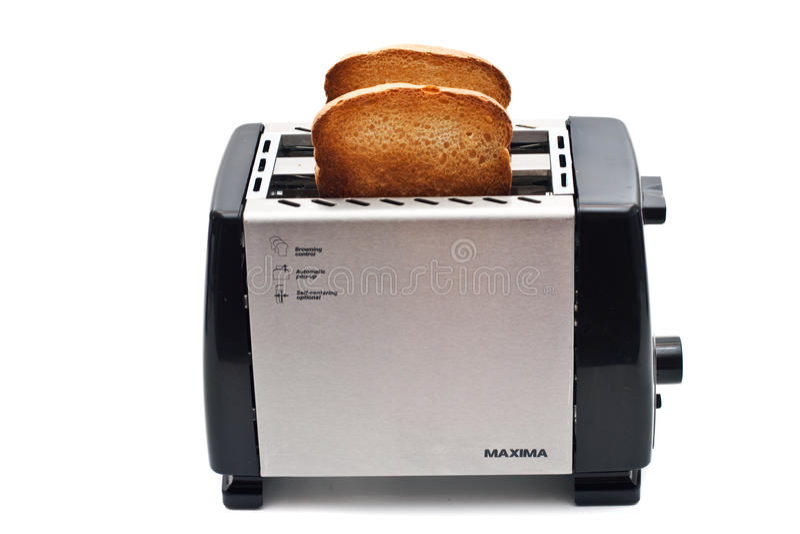 Gebraden brood in de broodrooster stock foto's