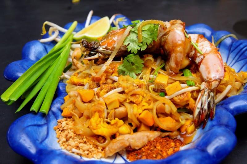 Gebraden de rijstnoedel van Thailand - Stootkussen Thai stock afbeelding