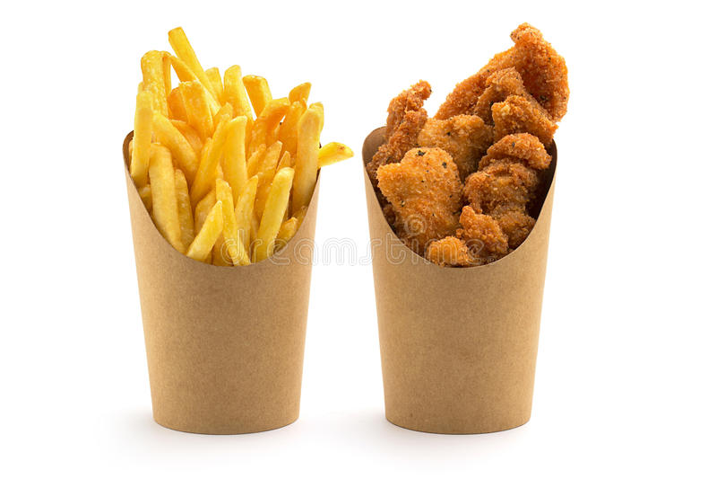 Gebraden gerechten en kippengoudklompjes stock afbeelding