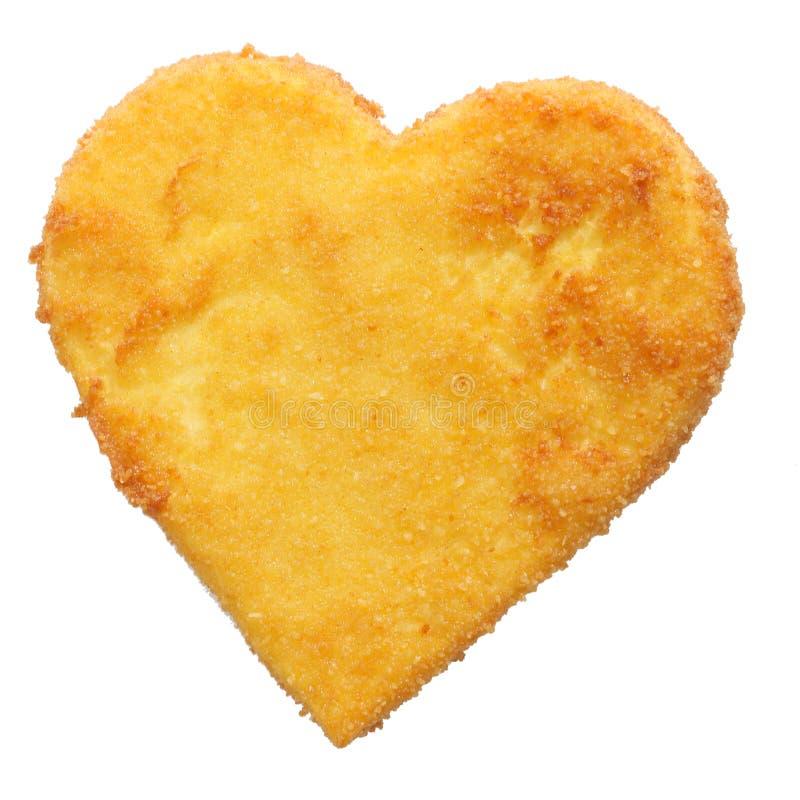 Gebraden kaas, vissen of kippenvlees in hartvorm stock afbeelding