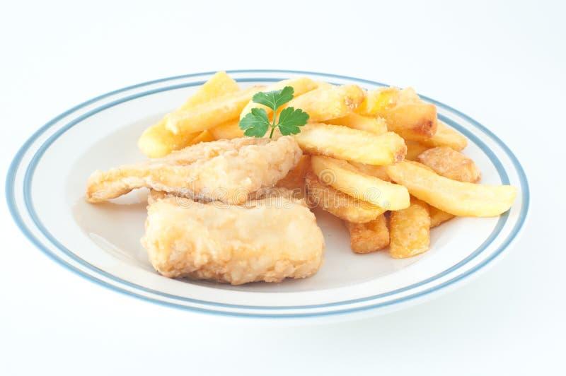 Gebraden kabeljauw met gebraden aardappels stock afbeelding
