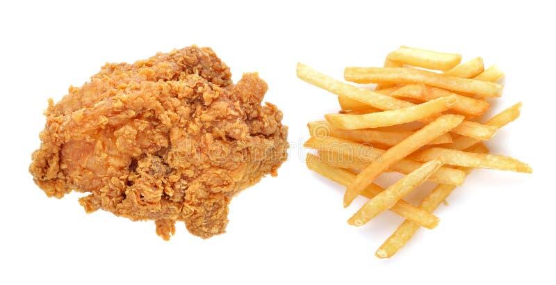 Gebraden kip en frieten stock afbeelding