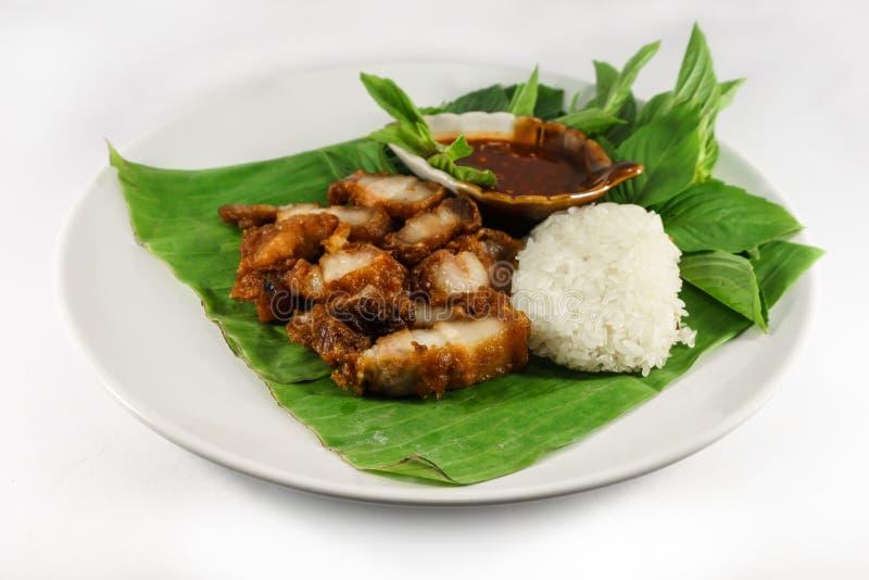 Gebraden varkensvlees en kleverige rijst met saus royalty-vrije stock afbeeldingen