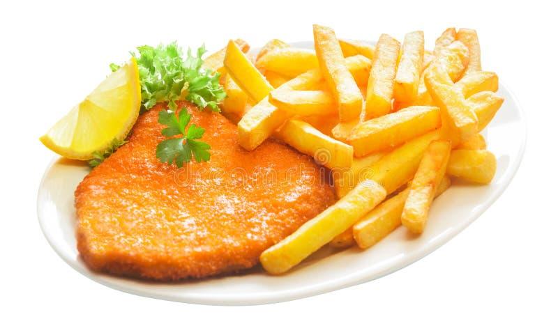 Gebraden verkruimeld kalfsvlees escalope met Frieten stock afbeelding