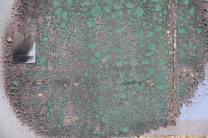 Gebrannte Wand mit Blasenbildungsfarbe lizenzfreies stockfoto