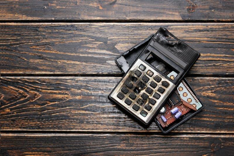 Gebrannter Taschenrechner stockbild