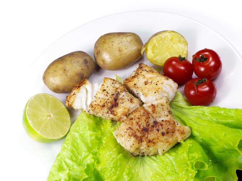 Gebratener Weißfisch auf einer Platte stockbild
