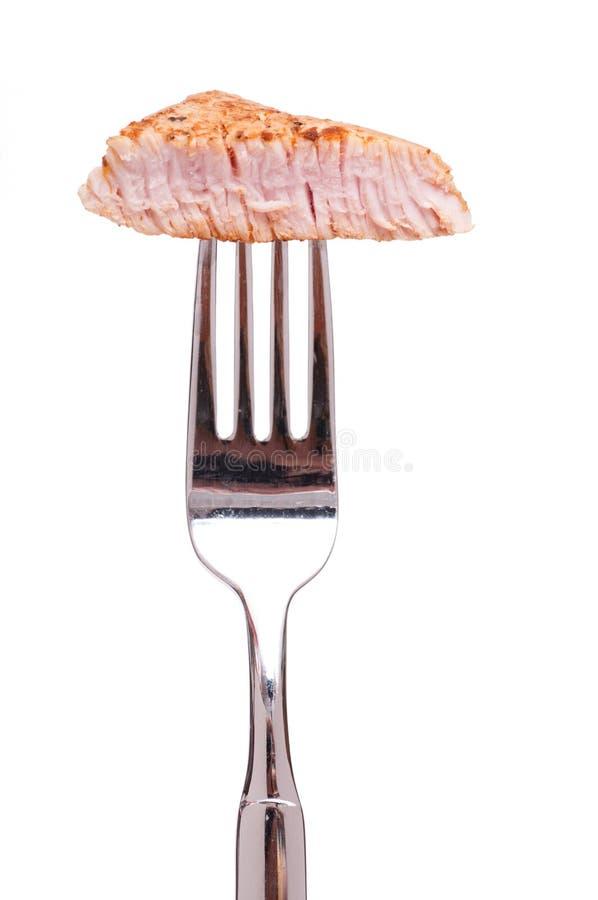 Gebratenes Kalbfleisch auf einer Gabel lizenzfreie stockbilder