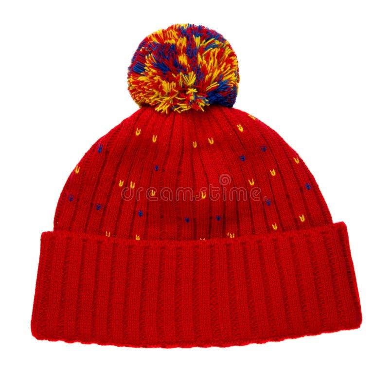 Gebreide die hoed op witte achtergrond wordt geïsoleerd hoed met pompon stock afbeelding