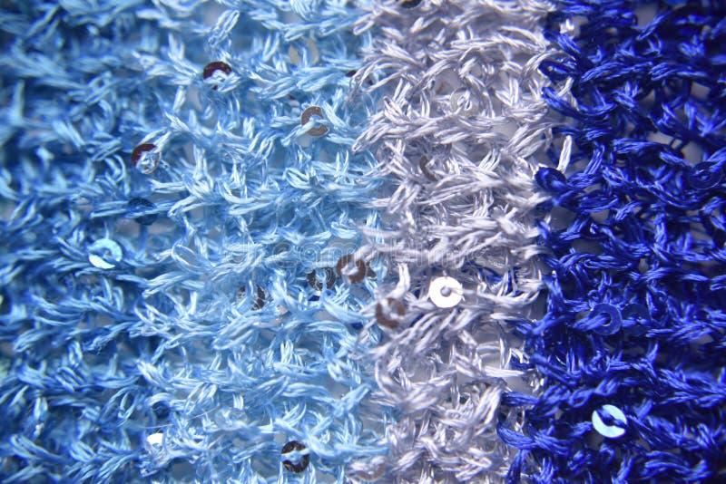 Gebreide textuur van stof met lovertjes stock foto's