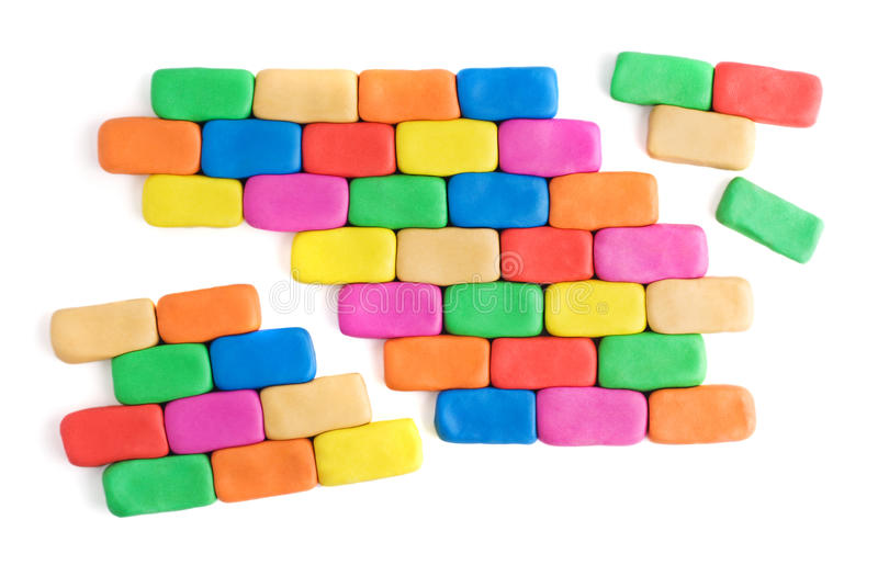 Gebroken kleurrijke muur stock afbeelding
