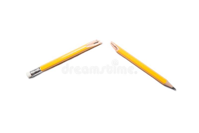 Gebroken potlood op witte achtergrond royalty-vrije stock afbeelding