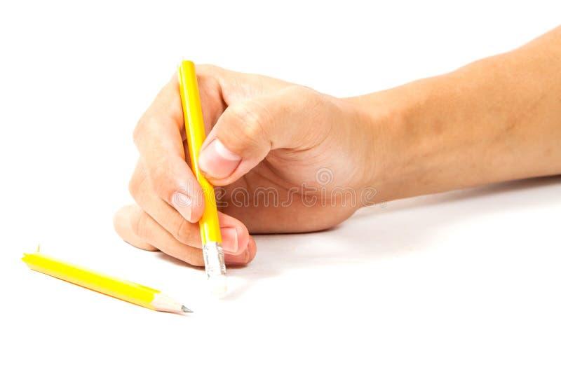 Gebroken potlood op witte achtergrond stock afbeelding