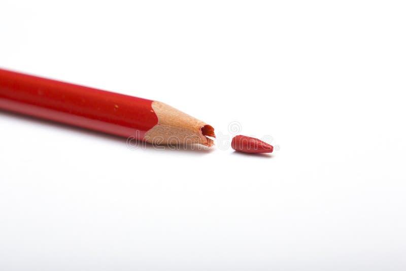 Gebroken rood potlood royalty-vrije stock fotografie