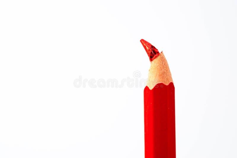 Gebroken rood potlood dicht omhoog macroschot royalty-vrije stock foto's