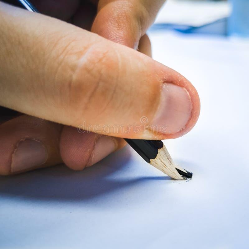 Gebroken van de potloodhand blauw vierkant formaat als achtergrond stock fotografie