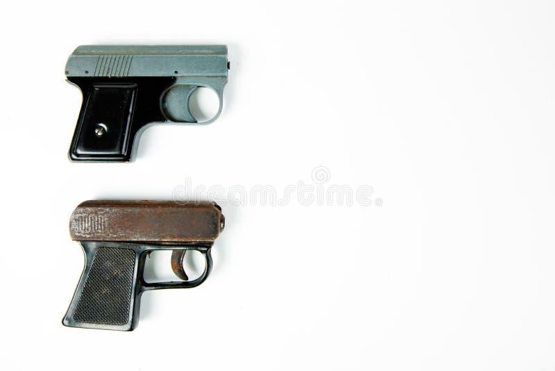 Gebruikt grijs aanzetpistool en ouder roestig aanzetpistool stock foto's