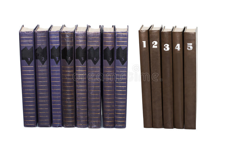 Gebruikte boekenvolumes met aantallen op dekking Acht turkooise kleur, vijf de bruine inzameling van het dekkingsboek Witte achte stock foto