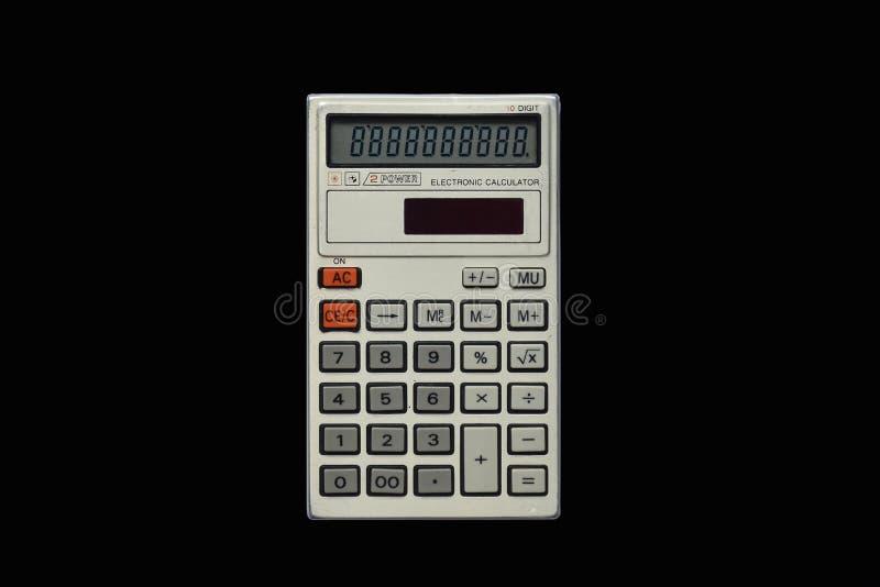 Gebruikte eenvoudige zakcalculator op geïsoleerde bkack hoogste mening als achtergrond royalty-vrije stock afbeelding