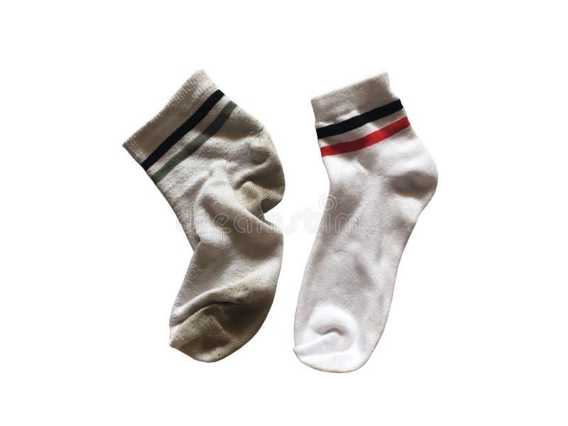 Gebruikte en nieuwe zachte die sokken op witte achtergrond worden geïsoleerd royalty-vrije stock foto