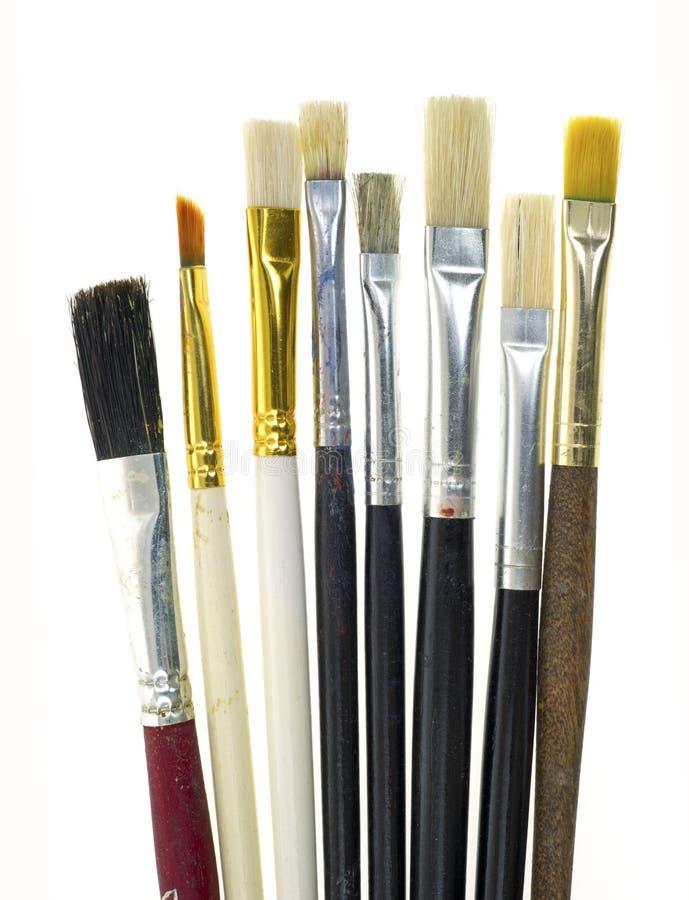 Gebruikte kunstenaarsborstels stock foto's