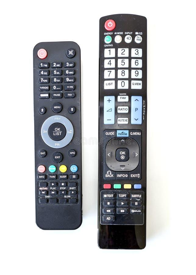 Gebruikte Satellietontvanger en TV-Afstandsbedieningen royalty-vrije stock afbeeldingen