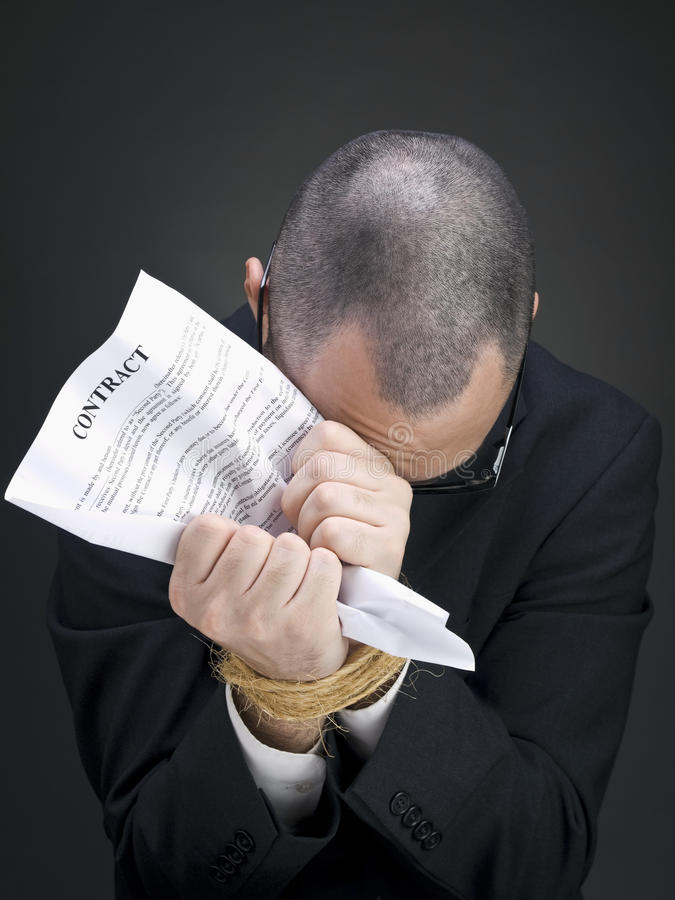 Gebunden an einem Vertrag lizenzfreies stockbild